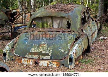 Car wreck at a junkyard - stock photo