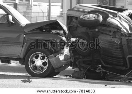 Car Wreck with Smashed Hood and Flipped Car