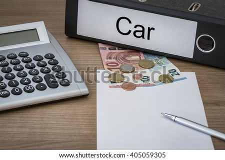 Car written on a binder on a desk with euro money calculator blank sheet and pen - stock photo
