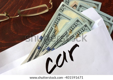 Car written on an envelope with dollars. Savings concept.