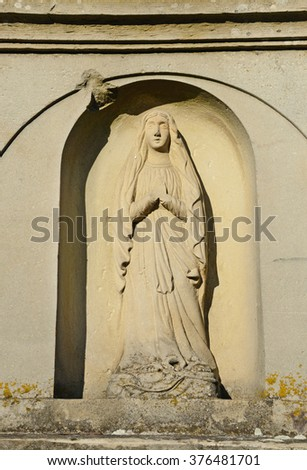 Cara stone statue on the tombstone in the cemetery in Ukraine  - stock photo