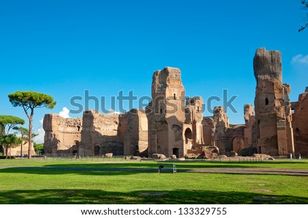 Caracalla springs ruins view from ground with big blue sky at Rome - Italy - stock photo