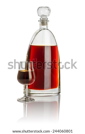 Carafe and snifter filled with brown liquid - stock photo