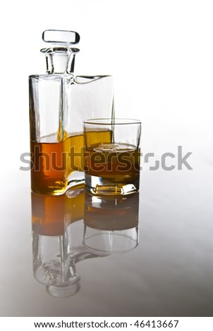 carafe of scotch whiskey or bourbon and drink