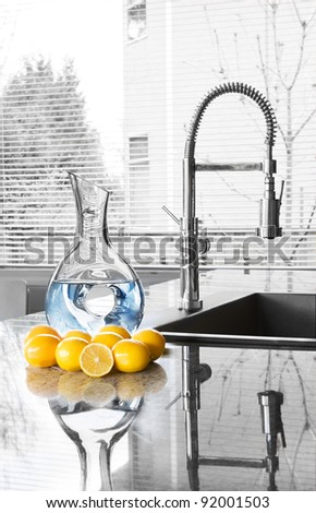 carafe of water and lemons in modern kitchen - freshness - stock photo