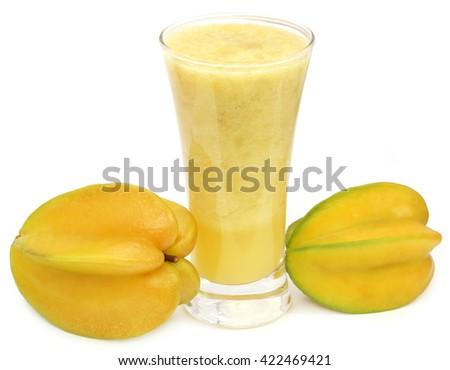Carambola juice over white background - stock photo