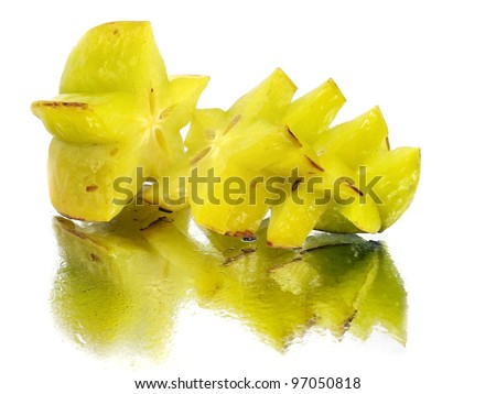 carambola - starfruit on a white background with water drops