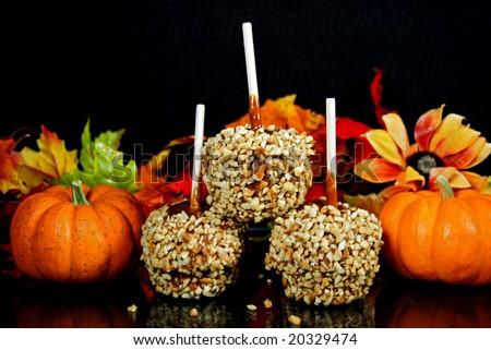 caramel apples and pumpkins - stock photo