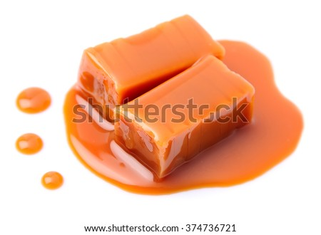 Caramel candies and caramel topping isolated on a white background. - stock photo