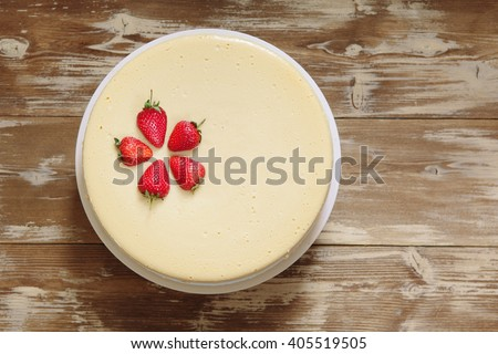 Caramel cheesecake with strawberry on the wooden background top view - stock photo