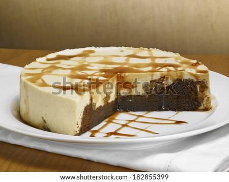 caramel chocolate cake, on a wood background - stock photo