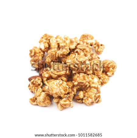 Caramel coated sweet popcorn isolated over the white background
