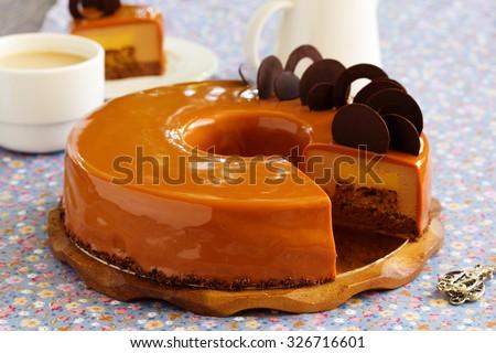 Caramel coffee cake in the mirror glaze. - stock photo