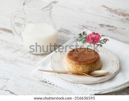 Caramel custard in a studio shot. A delicious dessert. - stock photo