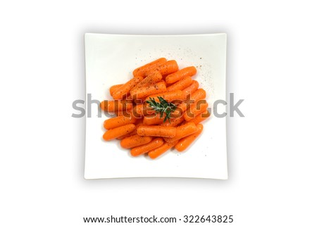 Caramel glazed baby carrots in a dish on white background, isolated, From above - stock photo