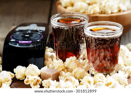 Caramel popcorn and cola in a glass, selective focus - stock photo