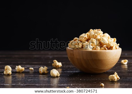 caramel popcorn in wooden bowl - stock photo