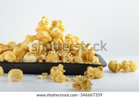 caramel popcorn on the black plate - stock photo