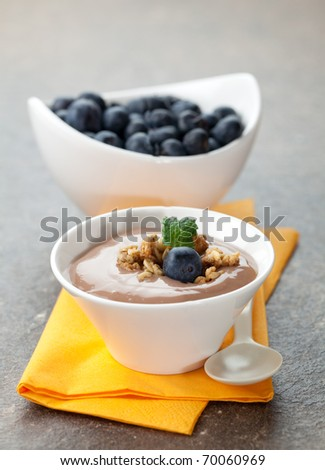 caramel pudding with blueberries in bowl