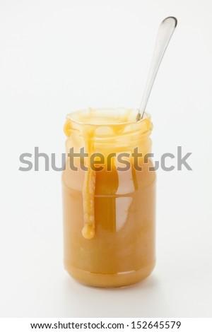 Caramel sauce in jar, close up - stock photo