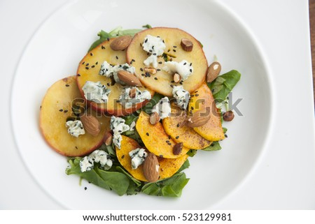 Caramelized apple salad and blue cheese with roasted almonds on top. For vegan and it's gluten free.
