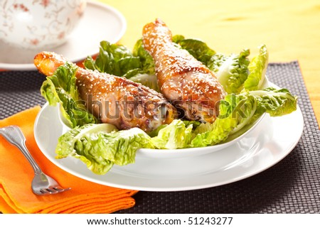 caramelized chicken thighs with sesame and lettuce - stock photo