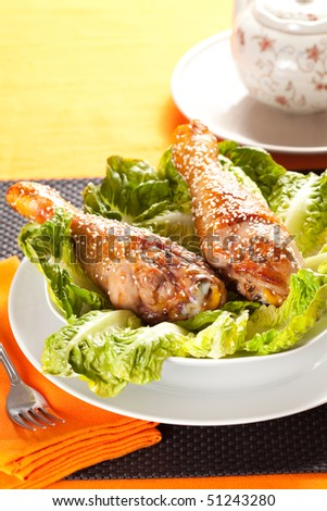 caramelized chicken thighs with sesame and lettuce