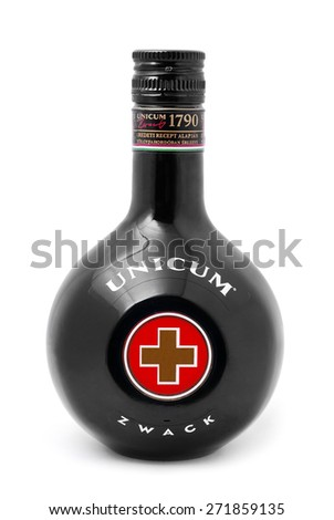 CARANSEBES, ROMANIA - DECEMBER 15, 2011: Unicum alcohol drink on white background, Unicum is a Hungarian herbal liqueur or bitters, drunk as a digestive and aperitif. - stock photo