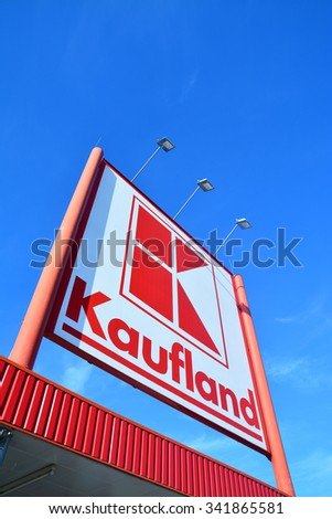 Caransebes, Romania - November 19, 2015: the kaufland supermarket company logo over blue sky background - stock photo