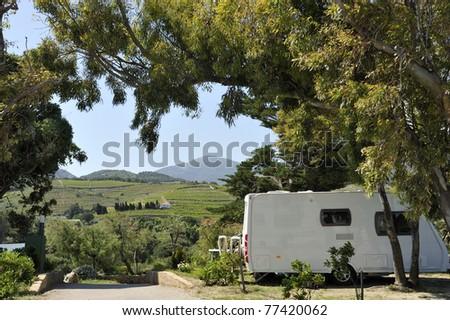 caravan at a camping. - stock photo