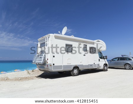 caravan by the sea, summer holidays, blue sky, greek island - stock photo