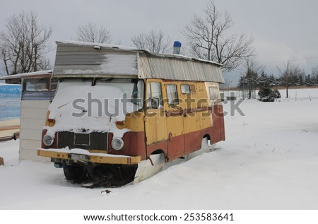 caravan  covered  by snow in winter - stock photo