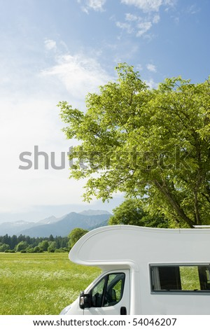 Caravan in a park - stock photo