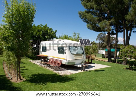 Caravan in a relaxing nature camp site  - stock photo