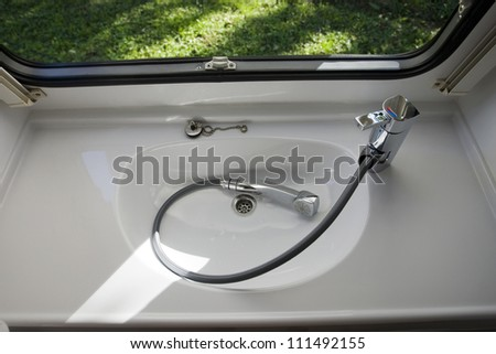 caravan interior travel trailer mobile home bathroom sink shower - stock photo