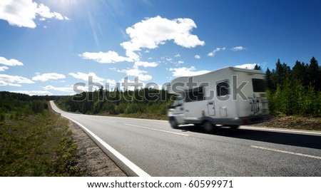 caravan on a country road - stock photo