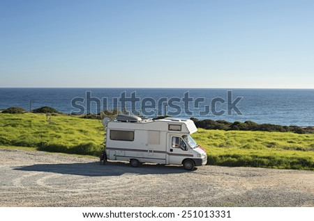 Caravan on the beach in front of the ocean in Sagres, Portugal - stock photo