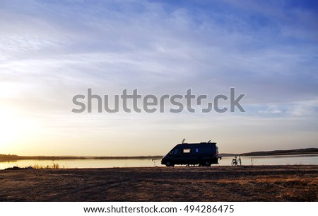 caravan silhouette in alqueva lake, Portugal