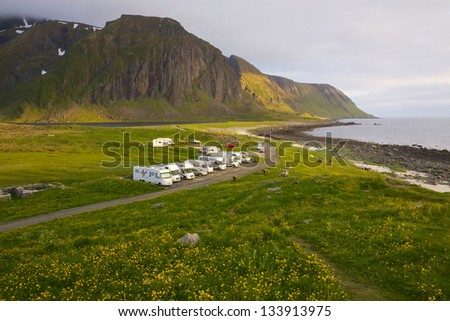 Caravans on Lofoten islands in Norway, popular spot for watching midnight sun - stock photo