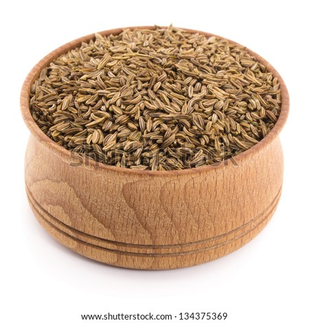 caraway seeds in a wooden bowl isolated on white - stock photo