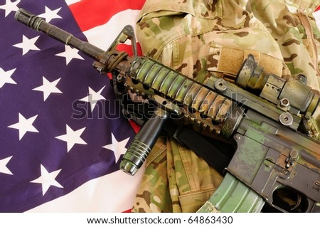 Carbine M4 and camo and US flag - stock photo