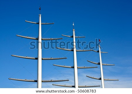 Carbon fiber masts with yards connected rigidly to the masts. - stock photo