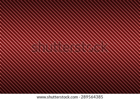 carbon kevlar texture background with red - stock photo