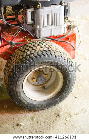 CARBONARA DI PO, ITALY - APRIL 19, 2016: Dirty wheel of a grass cut machine - stock photo