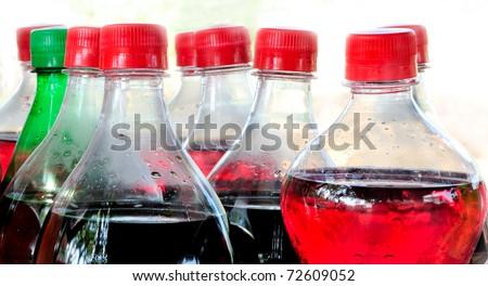 Carbonated soft drink bottles isolated on white background - stock photo
