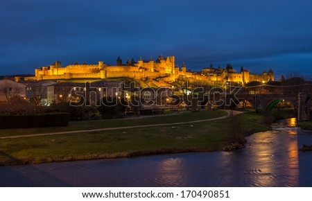Carcassonne fortress illuminated at evening - France, Languedoc-Roussillon - stock photo