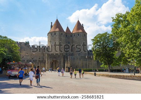 CARCASSONNE, FRANCE JULY 26, 2014: Tourists visiting the medieval fortress Cite de Carcassonne. The fortress is located in the French city of Carcassonne in the department of Aude. - stock photo