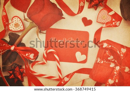 Card and roses on vintage background.Valentines background