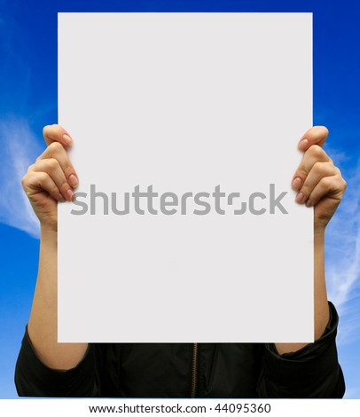 card blank in a hand on the sky backgraunds - stock photo