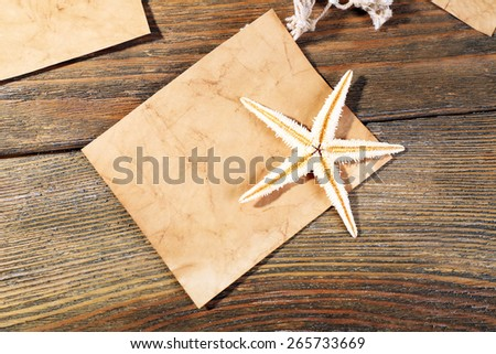 Card blank with sea star on wooden background